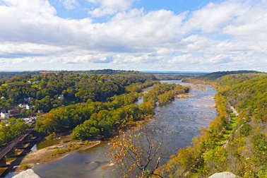 Aerial view on a trail along Potomac River and buildings near Harpers Ferry railway station.