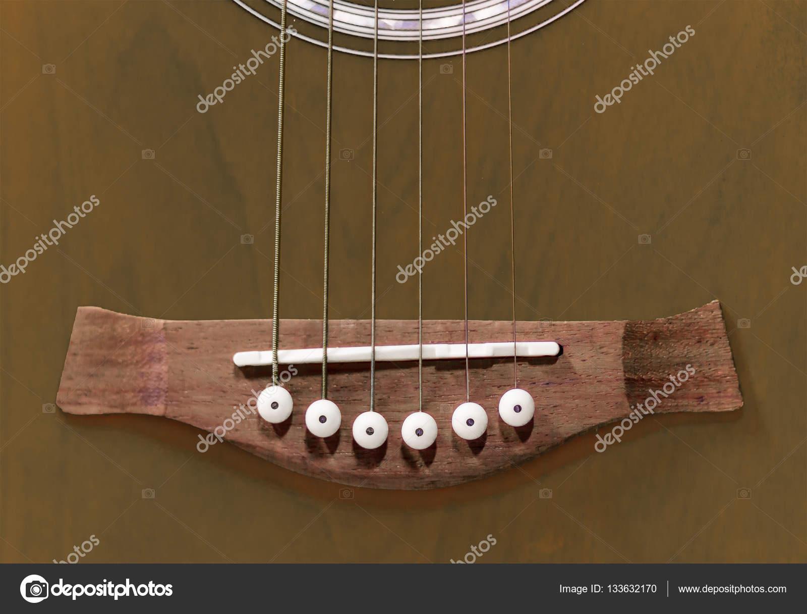 Acoustic Guitar Bridge With Saddle Bridge Pins And Strings Stock