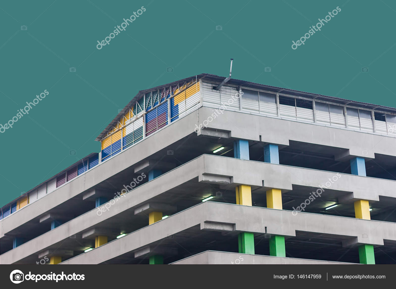 the office centre. Above Ground Parking Of The Office Center. Colored Columns. Concrete Construction. With An Centre M
