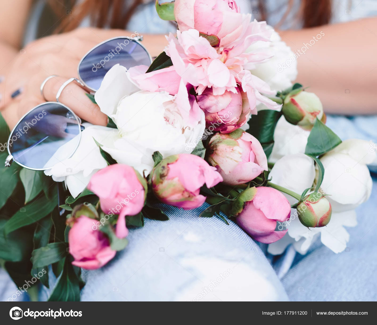 Young woman holding beautiful bunch peons her hands spring present young woman holding a beautiful bunch of peons in her hands spring present for a girl in a jeans outfit flowers bouquet photo by nicoleclaudia izmirmasajfo