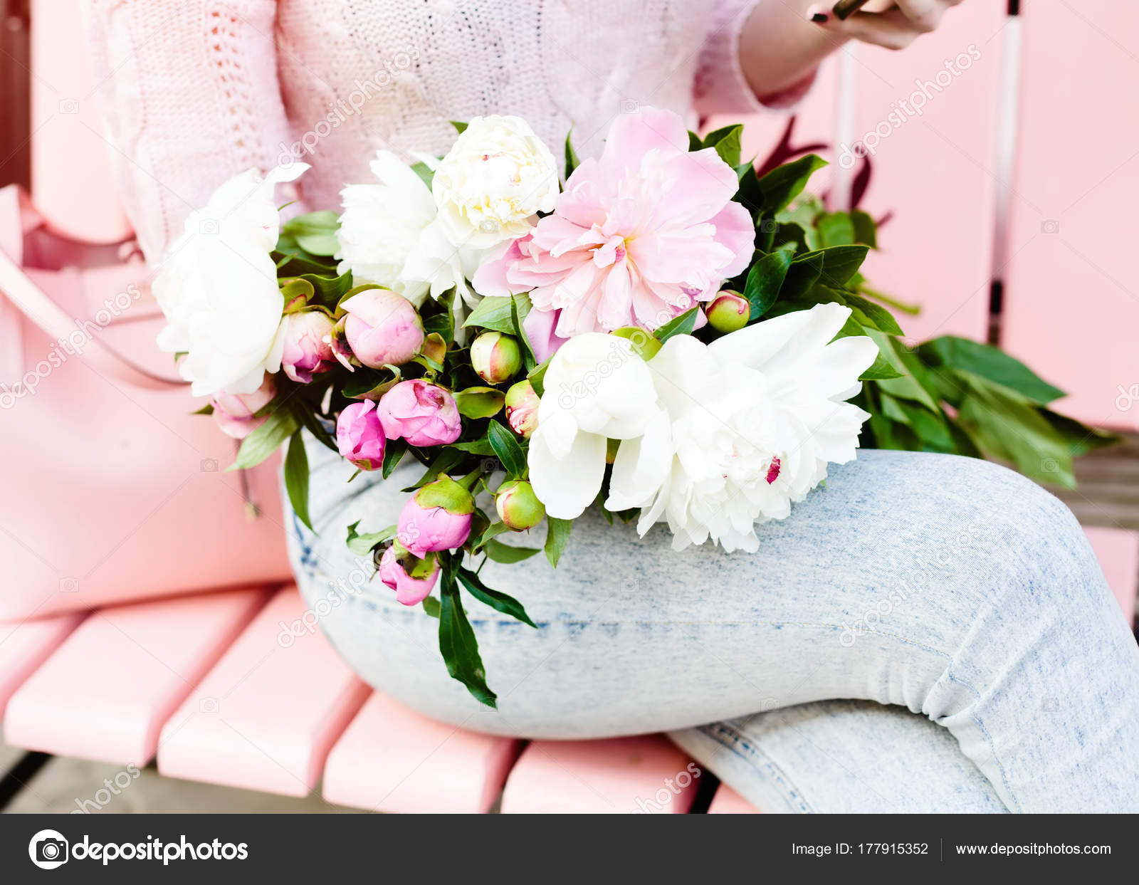 Young woman holding beautiful bunch peons her hands spring present young woman holding a beautiful bunch of peons in her hands spring present for a girl in a jeans outfit flowers bouquet outdoor cafe izmirmasajfo