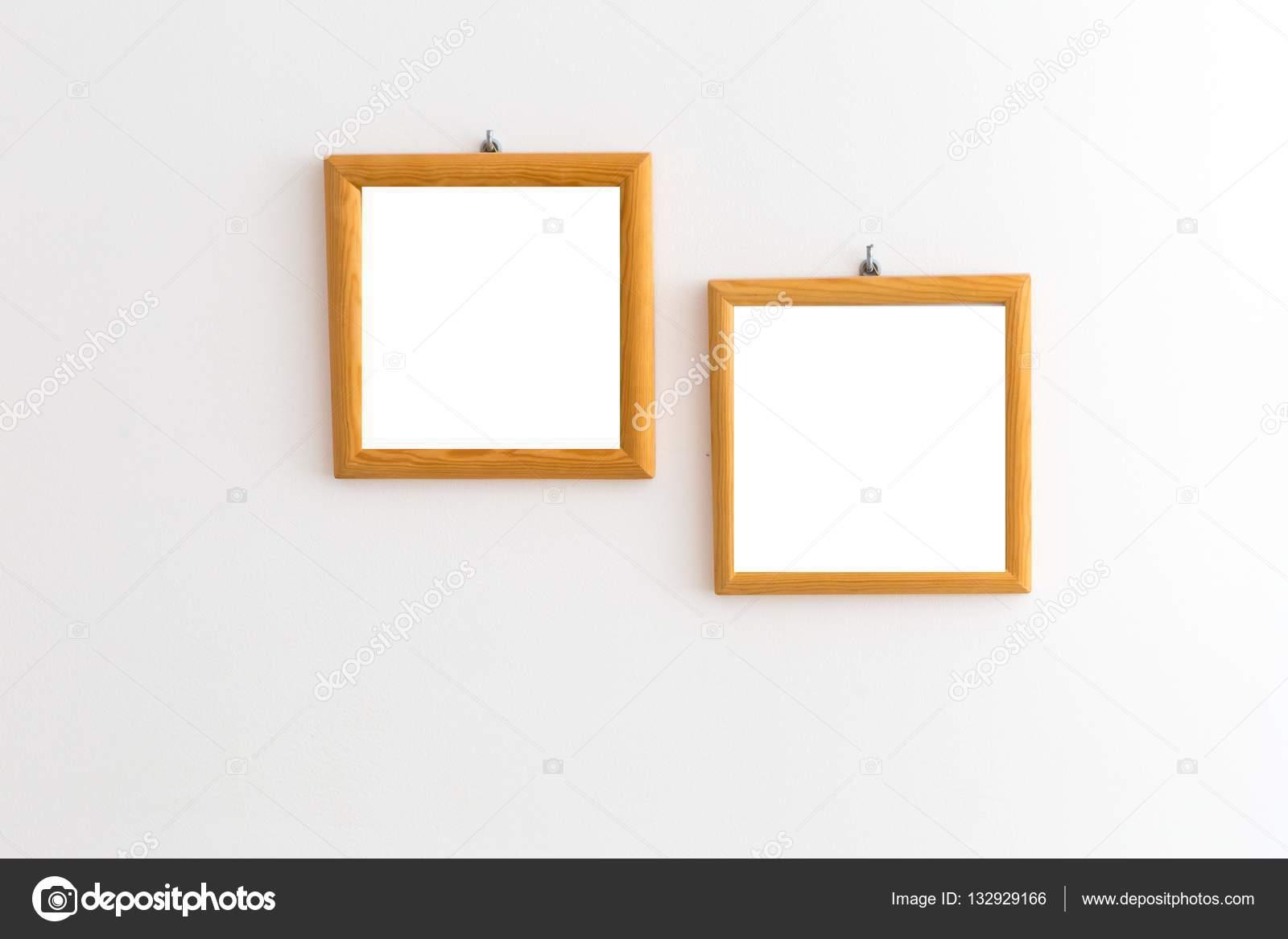 Two Wooden Frames On White Wall Stock Photo Milosz 132929166