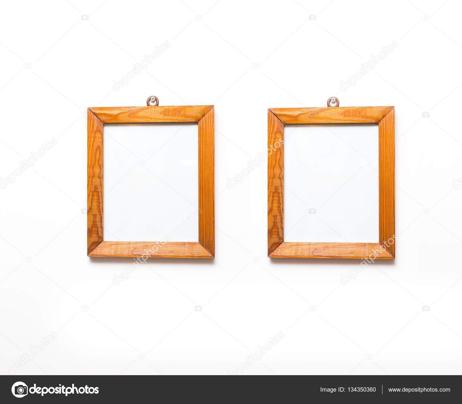 Two wooden frames on white wall. — Stock Photo © Milosz_ #134350360