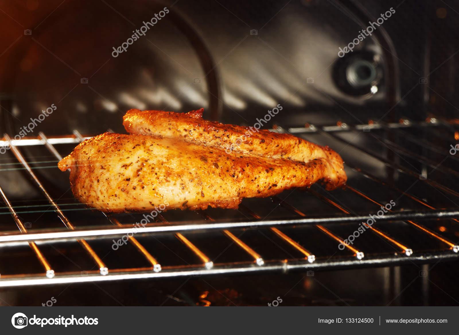 Chicken Gasgrill : Delicious golden chicken breast on gas grill u stock photo