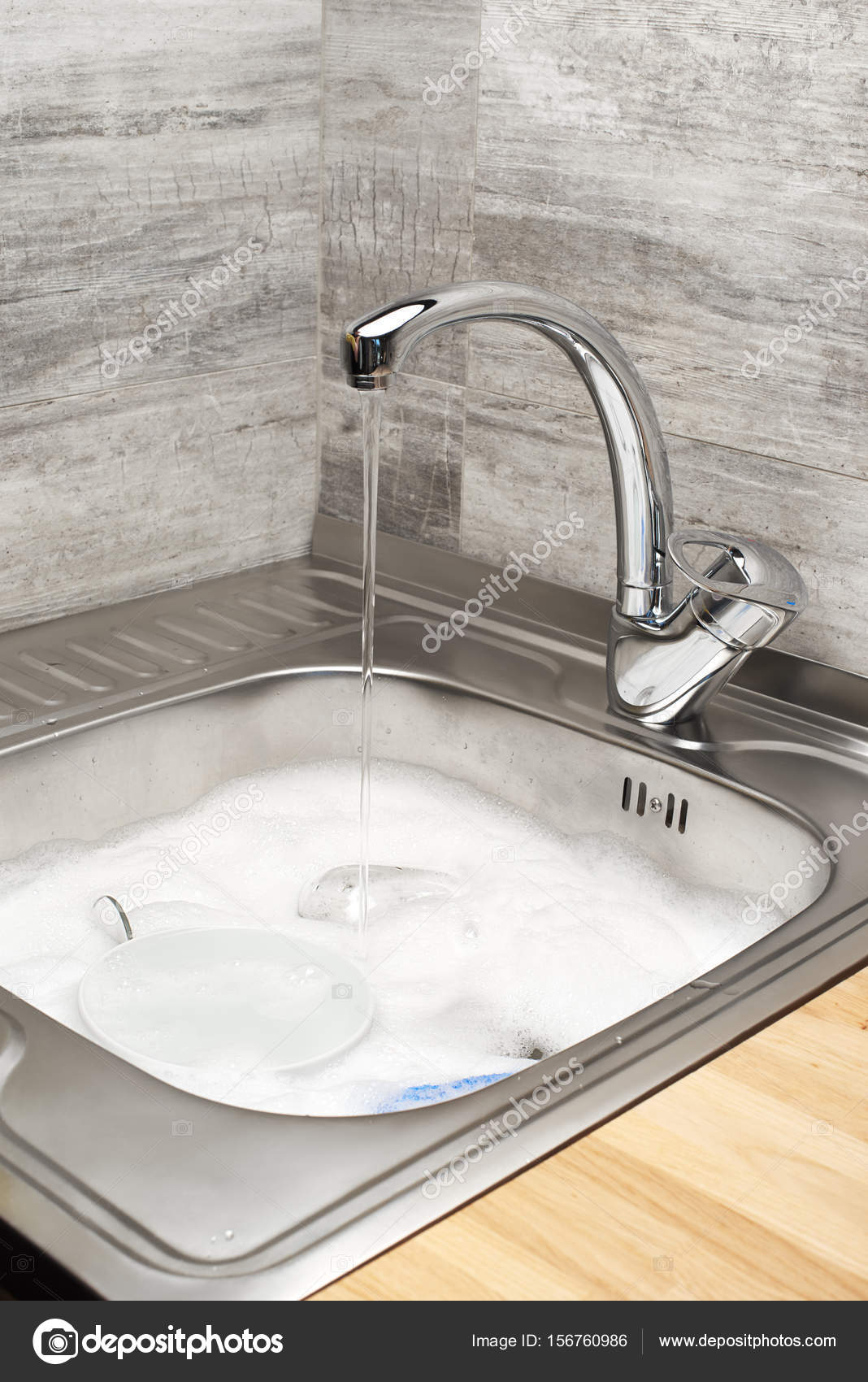 Kitchen Sink With Running Water Foam Tableware And Blue Sponge Stock Photo C Intelwond 156760986