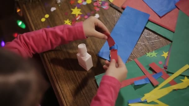 Little Girl Glue Handicrafts Made Of Colored Paper Stock Video