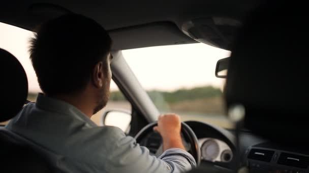 Businessman driving car.