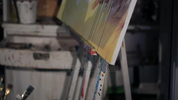 artist paints in oil on canvas. close-up on a picture