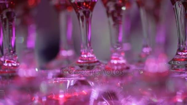 Glasses for alcohol. Festive drink. Bartender show.