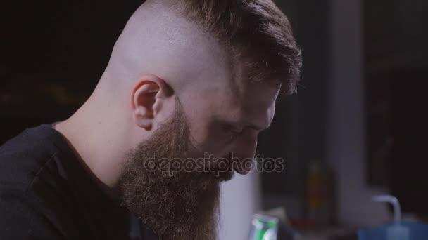 Tattoo artist make tattoo at the studio in 4K