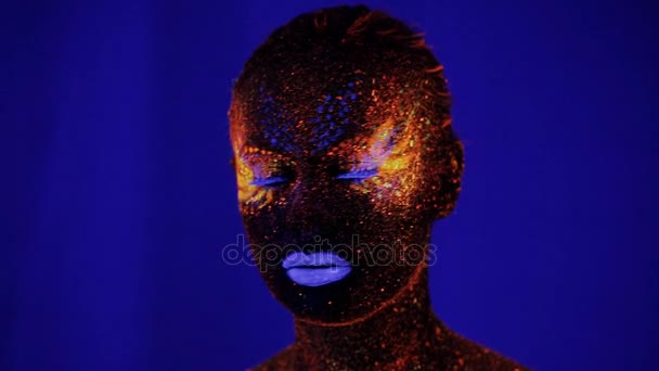 Woman face with fluorescent make up , creative makeup great for nightclubs , Halloween party, shows and music video