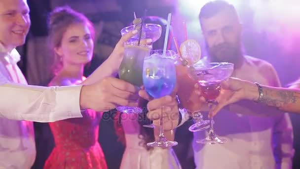 Friends toast their drinks at the lounge and have a great time