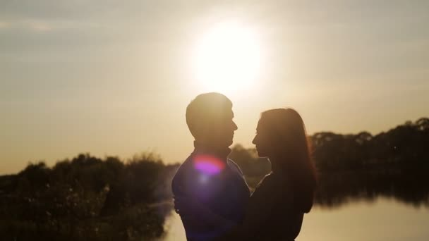 Romantic date at sunset. Lovers walk holding hands. Love story. Honeymoon. Love at first sight