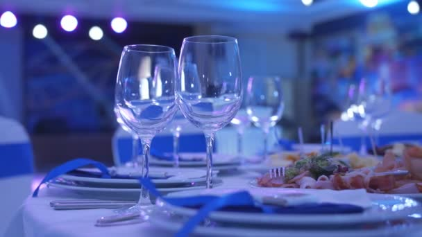 In anticipation of the beginning of the Banquet. Wine glasses are on the Banquet table in the restaurant.