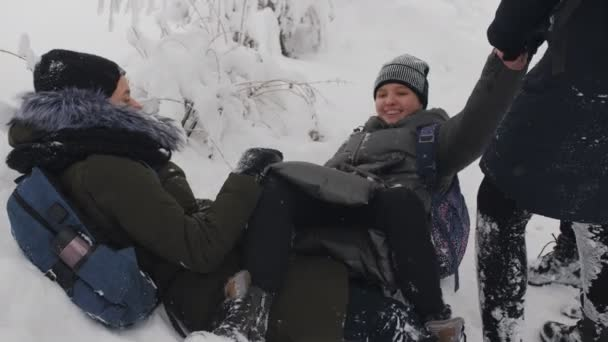 Fun in the snow. Teen Schoolgirls are having fun and playing in the snow after school.