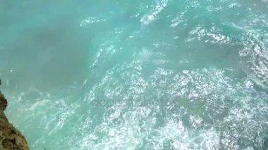 Beautiful landscape of wild nature of Bali, blue sea, cliff rock. 4K