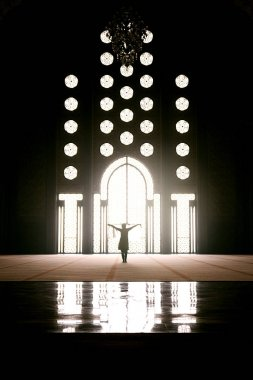 Silhouette of woman in an ancient mosque.