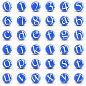 Numbers and letters on a bright blue balls.