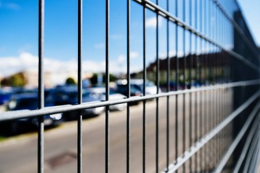 Close up Metal grille or fence of car parking.