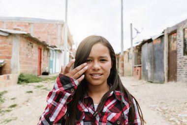 Portrait of beautiful girl in shanty town.