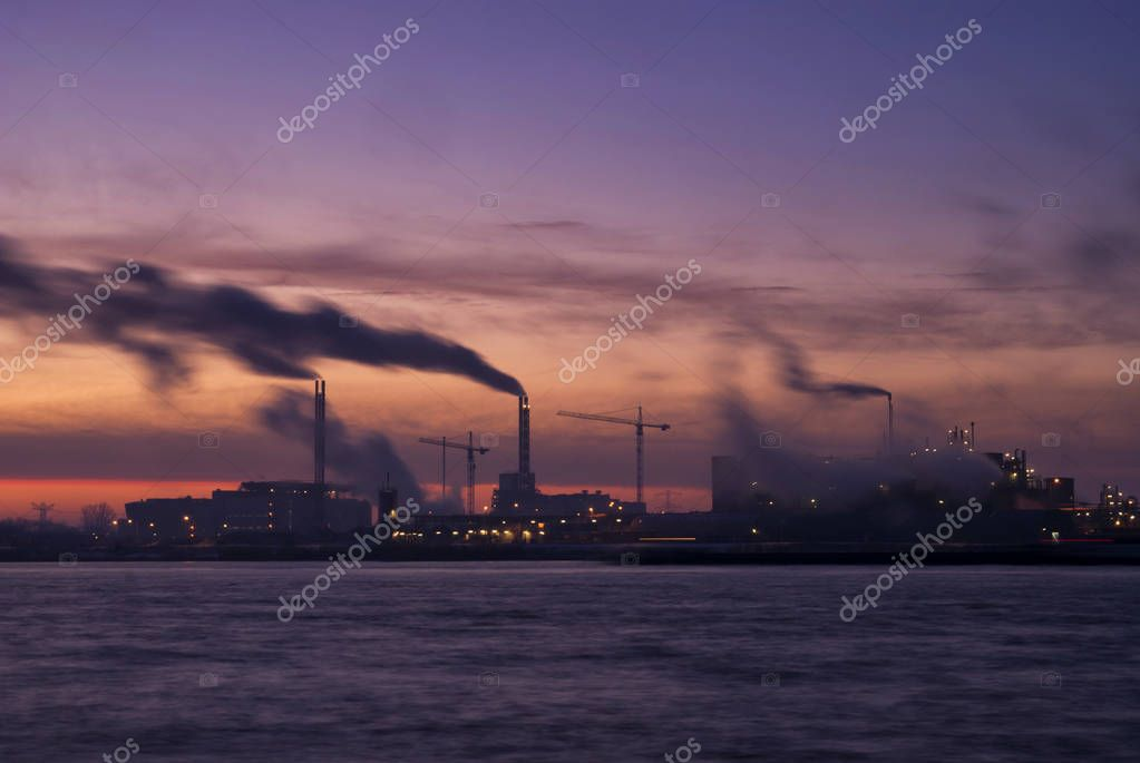 Sunrise above a chemical factory