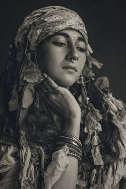 gypsy style young woman wearing tribal jewellery
