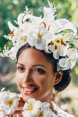 close up of beautiful young woman wearing wreath