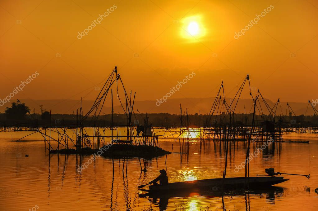 Traditional fishing tool and fishing boat in swamp
