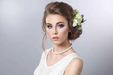 portrait of bride hairstyle with wreath on gray background