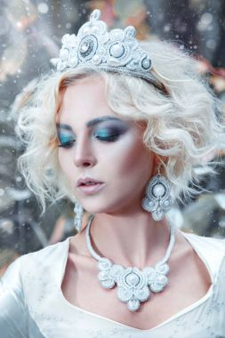 portrait of fairytale beauty of blonde woman in image of snow queen