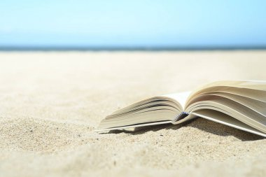 Open book on the beach