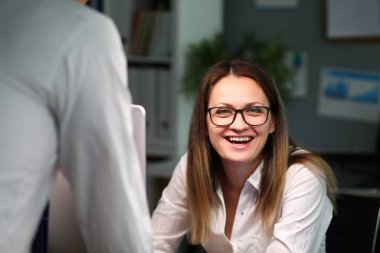 Cheerful woman in modern office