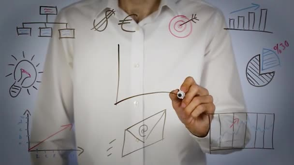 man drawing growth chart and writing strategy on transparent screen