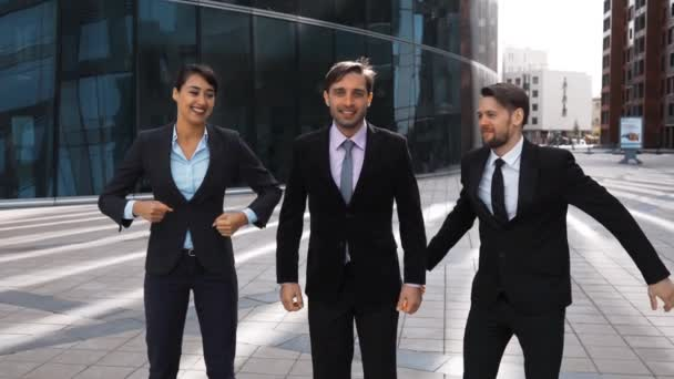 Businesspeople exult, laughing jump with happiness
