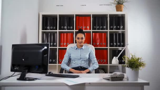 Businesswoman in office smiling portrait