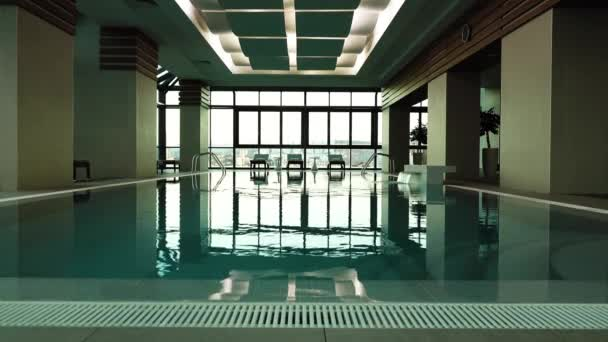 Empty swimming pool indoor of luxury hotel
