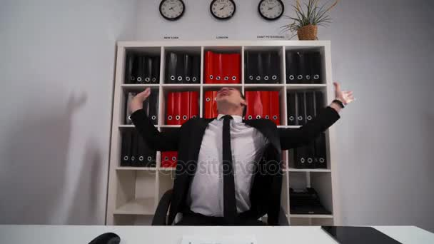 Businessman dancing sitting indoor in the office