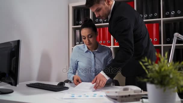 Employee woman and man colleague work with computer desktop