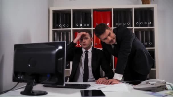 Two mature businessmen lose grat deal.