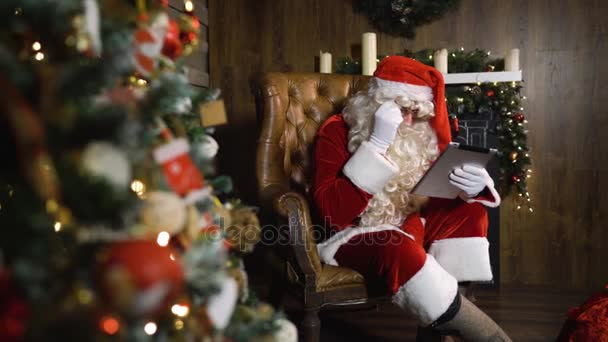 Santa Claus, dolgozó digitális pad tabletta