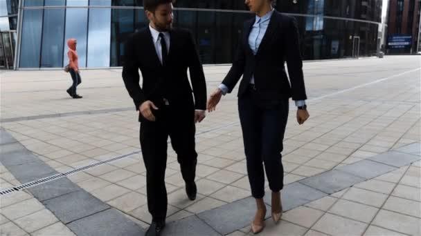 Colleagues, businessmen and businesswomen doing a handshake.