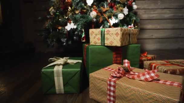 Christmas tree with beautiful gift boxes.