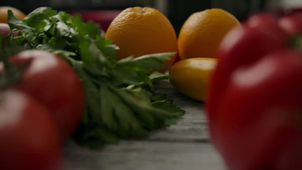 Herbs amidst fruits and vegetables on table