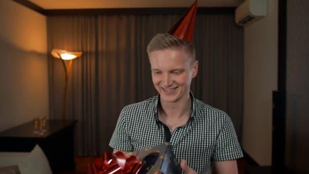 Happy adult caucasian man get gift box.