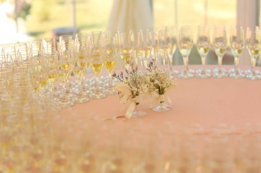 Decorated wedding reception table with champagne glasses
