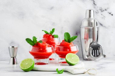 Berry Slushie with lime, Summer refreshing drink in serving glas