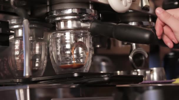 Coffee machine filling a cup with hot fresh coffee. Preparation of coffee, close up.