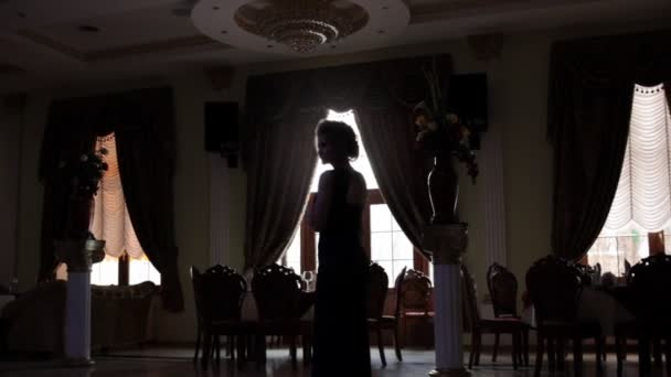 Woman posing in luxurious banquet hall
