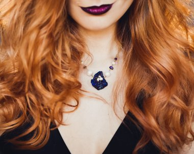close-up portrait of young beautiful red-haired girl