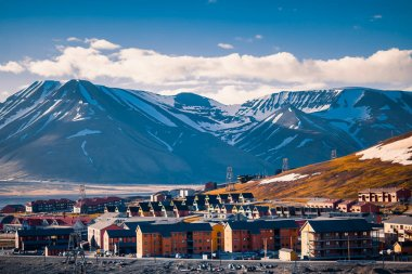 landscape nature of the mountains of Spitzbergen Longyearbyen Svalbard building city on a polar day with arctic summer in the sunset
